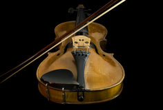 Old violin and bow, low angle view Stock Image