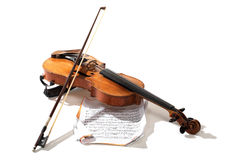 Old violin, bow and notes. Old violin bow and notes crossed isolated on white Stock Images