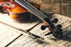 Old Violin with bow on notes Royalty Free Stock Photography