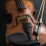 Old Violin with bow. On wooden table Stock Images