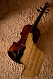 Old violin with burnt music sheet Royalty Free Stock Image
