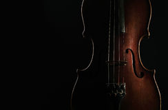 Old violin on dark background Royalty Free Stock Photos