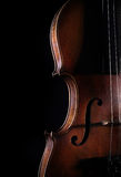 Old violin on dark background. Closeup view. Royalty Free Stock Photography