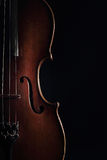 Old violin on dark background. Closeup view. Royalty Free Stock Photo