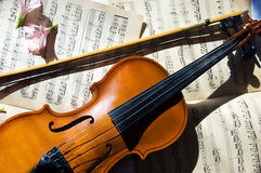 Old violin, fiddle-stick and music sheet Royalty Free Stock Image