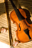 Old violin, fiddle-stick and music sheet Royalty Free Stock Images
