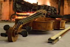 Old violin by the fireplace Royalty Free Stock Images