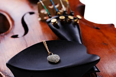 Old Violin with jewel Stock Photo
