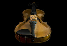 Old violin, low angle view. From chinrest to scroll, black background Royalty Free Stock Photo