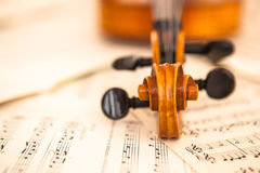 Old violin lying on the sheet of music Royalty Free Stock Images