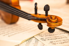 Old violin lying on the sheet of music Royalty Free Stock Photography