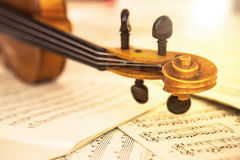 Old violin lying on the sheet of music Royalty Free Stock Photos