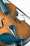 Old violin lying on the sheet of music, music concept Royalty Free Stock Photos