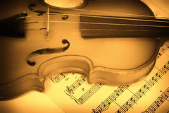 Old violin and musical notes Royalty Free Stock Photography