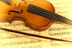 Old violin and musical notes stock image