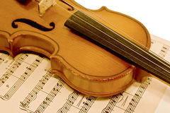 Old violin and musical notes Royalty Free Stock Image