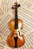 Old violin with musical notes Royalty Free Stock Photo