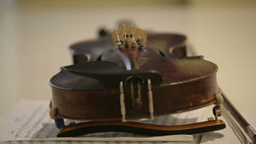 Old violin on musical notes book stock video footage