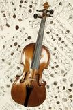 Old violin with musical notes Stock Image