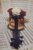 Old violin with musical notes and rose Stock Image