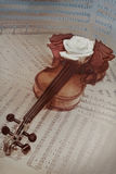 Old violin with musical notes and rose Royalty Free Stock Photography