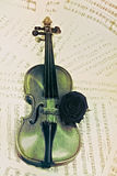 Old violin with musical notes and rose Royalty Free Stock Photo