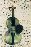 Old violin with musical notes and rose Stock Photo
