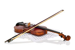 Old violin and notes Royalty Free Stock Photo