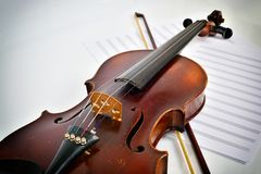 Old violin on notes Royalty Free Stock Images