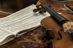 Old violin. With notes on the table Royalty Free Stock Photos
