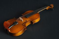Old violin. On black background in the studio Royalty Free Stock Photos