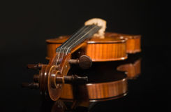 Old violin over black Royalty Free Stock Photos