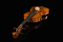 Old violin over black Royalty Free Stock Image