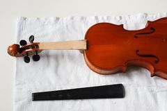 Old violin restoration: detached fingerboard and body with head stock photos