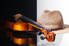 Old violin and straw hat  on black and white background. And glass desk Royalty Free Stock Photos