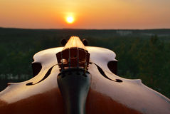 Old violin at sunset. Royalty Free Stock Images