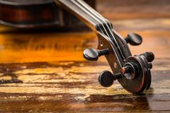 Old violin in vintage style on wood Royalty Free Stock Images