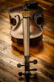 Old violin in vintage style on wood Royalty Free Stock Photos