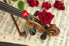 Old violin on wooden table. Detail of old violin. Invitation to the Violin Concerto. I love classical music. Sale of antique violi Stock Images
