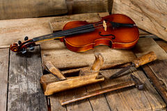 Old violin in a workshop. An old violin in the conservator`s workshop Royalty Free Stock Photo