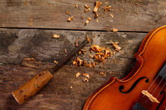 Old violin in a workshop. An old violin in the conservator`s workshop Royalty Free Stock Photography