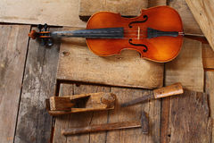 Old violin in a workshop. An old violin in the conservator`s workshop Royalty Free Stock Image