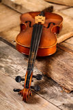 Old violin in a workshop. An old violin in the conservator`s workshop Royalty Free Stock Photos