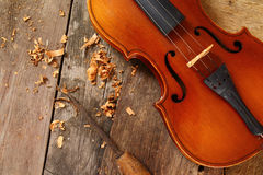 Old violin in a workshop. An old violin in the conservator`s workshop Royalty Free Stock Images