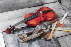 Old violin in a workshop. An old violin in the conservator`s workshop Stock Image