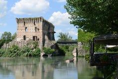 Old Visconti bridge in Valeggio sul Mincio. Visconti bridge over the Mincio river, 14th century, Valeggio sul Mincio, Veneto, Italy Royalty Free Stock Photo