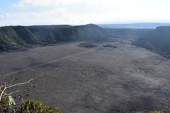 Dormant volcano crater filled in with rock with ridge and rain forest surrounding it stock image