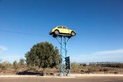 Old Volkswagen Beetle as Junkyard Sign Stock Photos