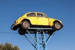 Old Volkswagen Beetle as Junkyard Sign Stock Photography