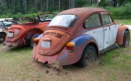 Old Volkswagen cars. Old and abandoned Volkswagen cars in a junkyard Royalty Free Stock Photo